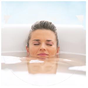 Woman taking Alka Bath